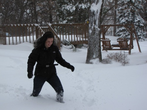 Me geeking out over the knee-deep snow on Christmas Day.